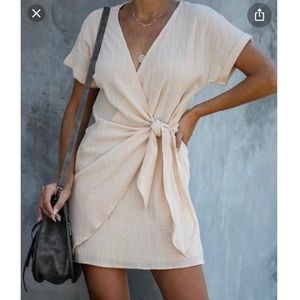 Kauai Crush Women's Wrap Dress. Ivory size small.